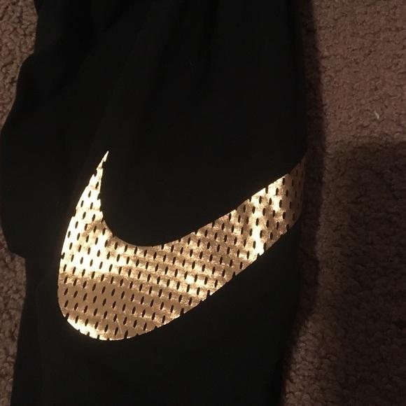 Nike Pants Black Leggings With Gold Symbol Poshmark