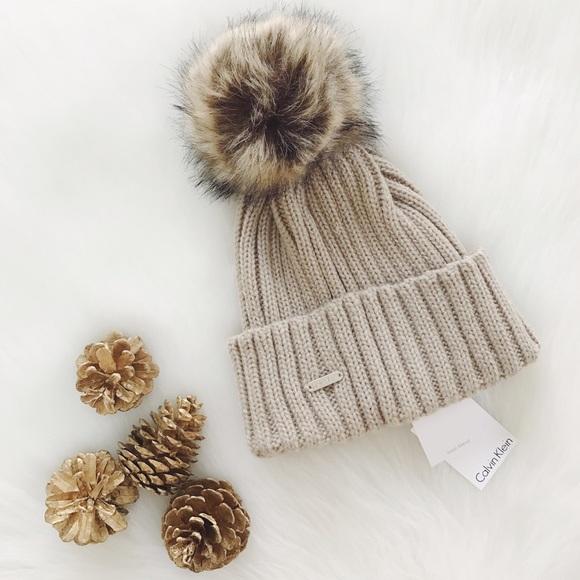 be10c0c3 Calvin Klein Accessories   1 Day Sale Faux Fur Pom Pom Hat   Poshmark