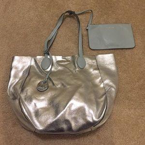 Michael Kors Handbags - Michael Kors Large Silver/pale blue Reversible Bag