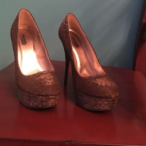 Women's size 7 Brown and gold leopard high heels