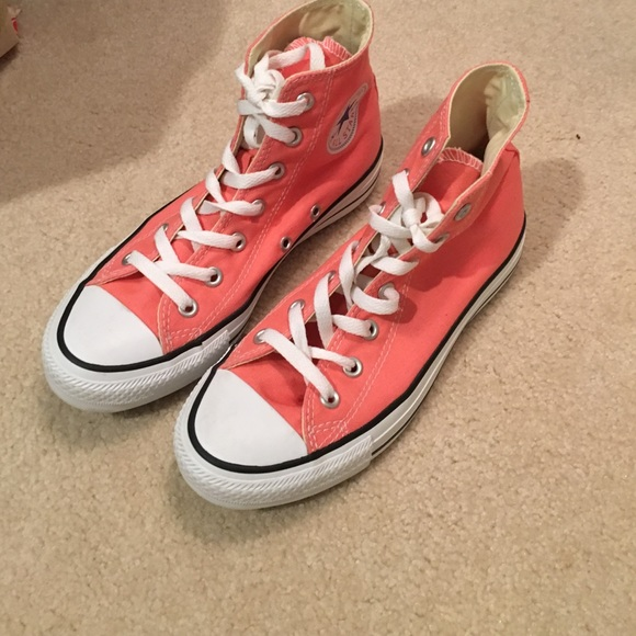 Coral colored All Star Converse high top sneaker.