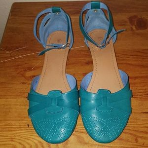 Teal round toe flats with a strap around the ankle