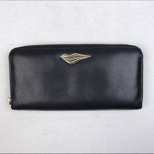 DVF black leather wallet with gold lips ornament