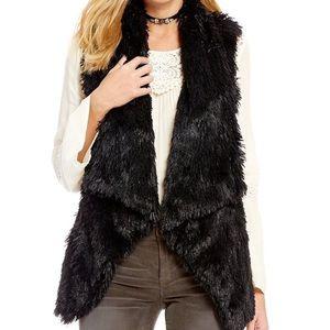 faux fur vest.  Black and cream!