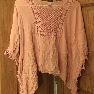 Peach lace high low blouse.