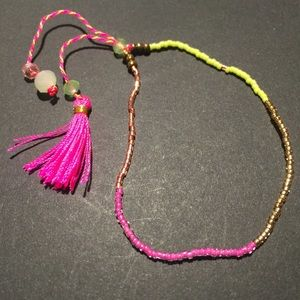Jewelry - Pink and yellow bohemian tassel bracelet