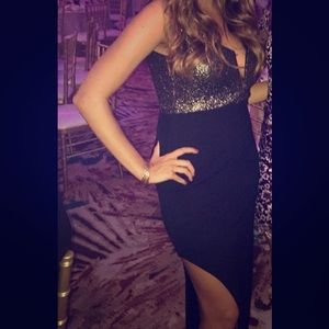 Nasty Gal Dresses & Skirts - Black and gold dress with slit.