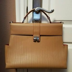 Tumi Handbags - ●SALE●AUTHENTIC LEATHER TUMI SATCHEL