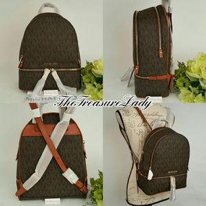 d4f883a891e3 Michael Kors Bags - Michael Kors Rhea zip Signature backpack brown MK