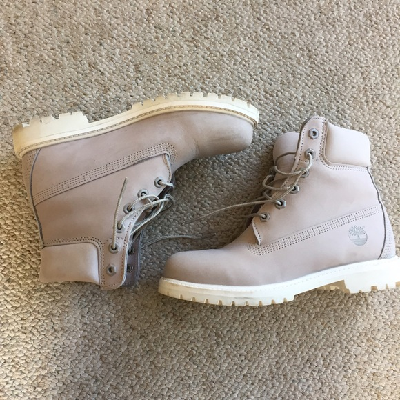 Light gray timberland boots with white sole. M 5855a7ba9c6fcfdb1302be36 ce805d7c1c1f