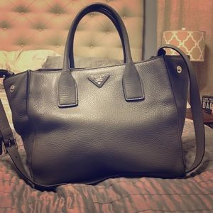 Prada Handbags - REDUCED - Gray pebbled leather cross-body tote.