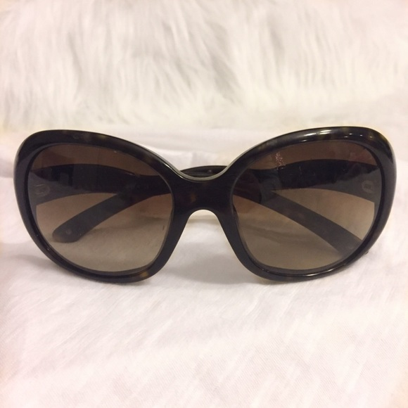 65de33885bb73 Prada Black   Brown Tortoise Shell Sunglasses. M 58560bb256b2d6f20902ccec.  Other Accessories ...