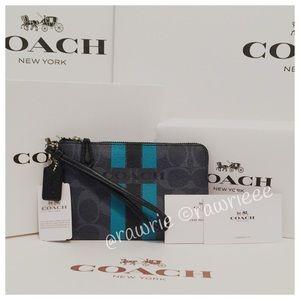 Coach Handbags - New Coach signature denim wristlet & gift box
