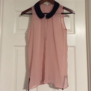 Pink sleeveless button up with black trim