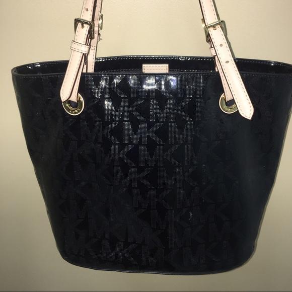 6dda6839d61314 Michael Kors Jet Set Patent Leather Signature Tote.  M_58580a64c6c79552f303549e. Other Bags ...