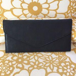 Handbags - Slim black envelope clutch, faux leather