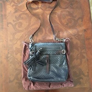 Carla Mancini cross body leather purse.