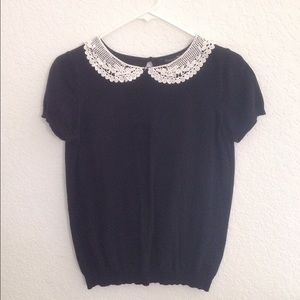 Peter Pan collar shirt.