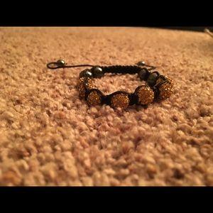 NWOT gold & black bracelet
