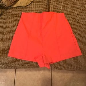 Coral colored stretchy shorts