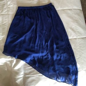 As symmetrical blue skirt