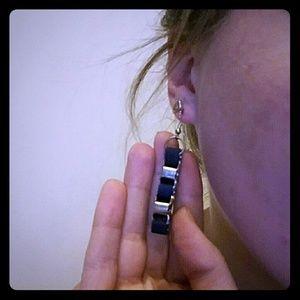 Blue ribbon gold chain earrings.