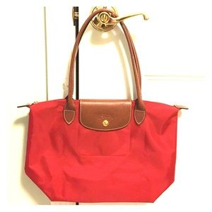 Longchamp le pliage tote in red.
