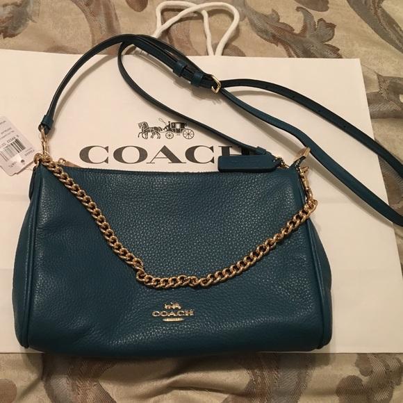 d3c02ca815107 Coach Handbags - Coach Atlantic Pebbled Leather Carrie Crossbody