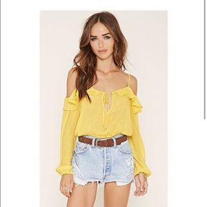 Yellow off the shoulder ruffle crop top