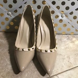 Tan pumps with studs