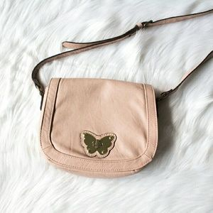 Blush crossbody bag with butterfly closure