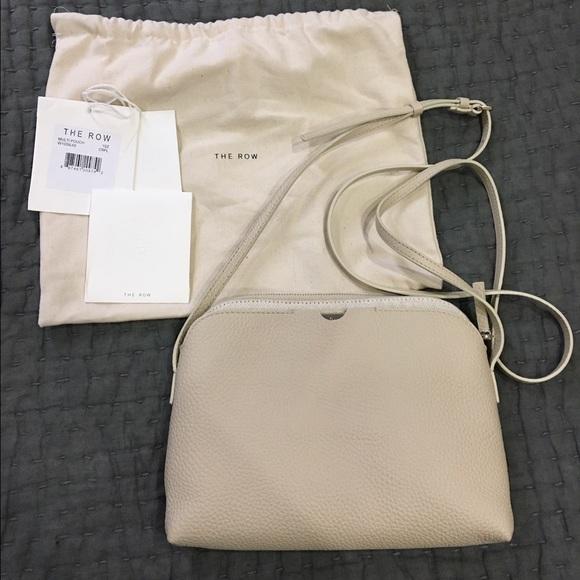 60b4ff929 The Row Bags   Multi Pouch Crossbody   Poshmark