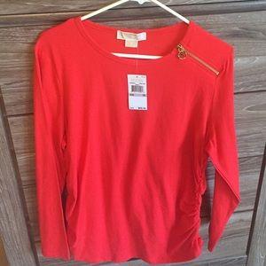 Red Michael Kors shirt.