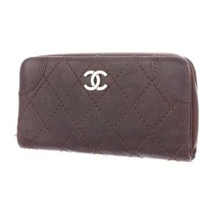 CHANEL Handbags - CHANEL Outdoor Ligne Quilted Wallet