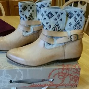 Light colored leather and material boots.
