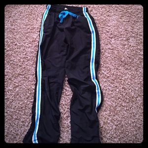 Justice black athletic pants with white/teal trim