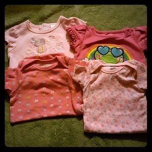 A bundle of 4 girls onesies, 3 NB & 1 3months-