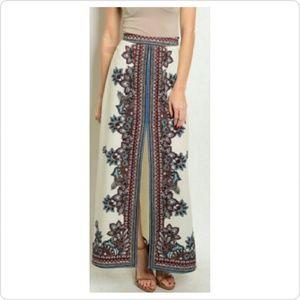 lulumari Dresses & Skirts - Cream maxi skirt with burgundy print.
