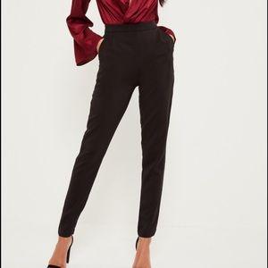 Tall black cigarette trousers