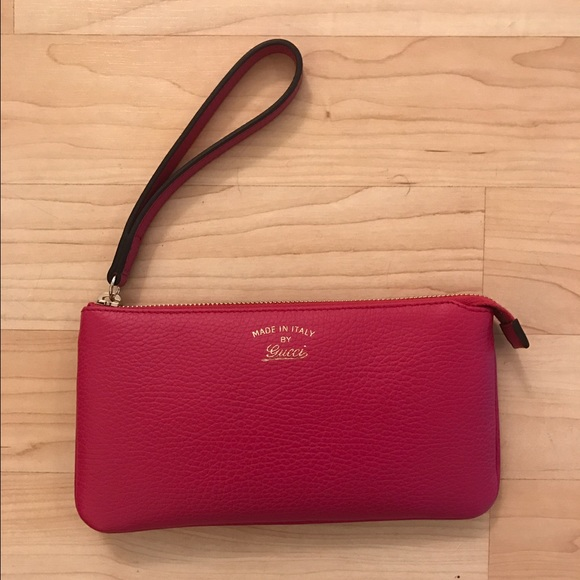 2164766ccbf Gucci Swing leather wristlet