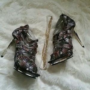 Jennifer Lopez Shoes - J. Lo snakeskin platforms