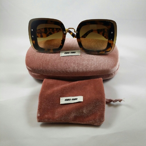 093bab5b474 MIU MIU SQUARE BUTTERFLY SUNGLASSES. M 58664848d14d7bca310228d4. Other  Accessories ...