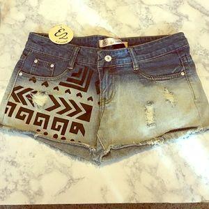 Native print acid wash denim shorts