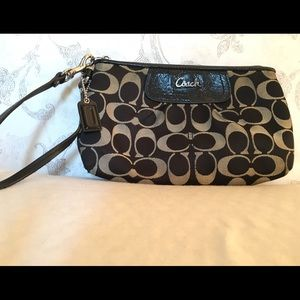 Coach clutch purse: Black and gray wristlet bag.