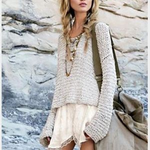 Asymmetrical net-like sweater