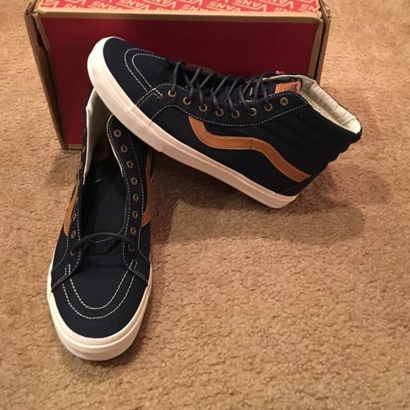 b58606c891a974 Vans Sk8 hi Reissue Coated Canvas Sneakers