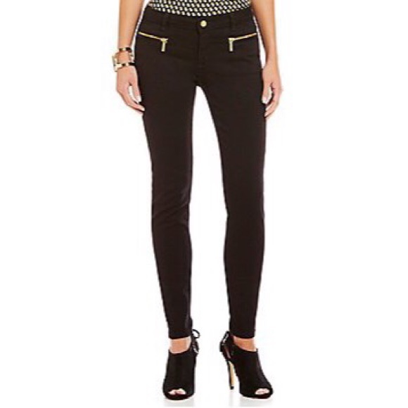Black skinny jeans with gold ankle zips