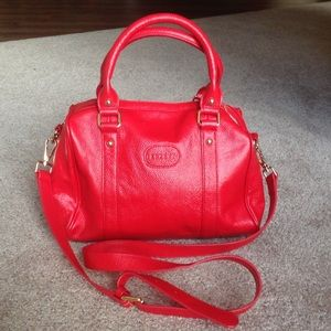 Terzetto red pebble  leather crossbody bag