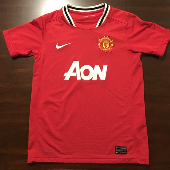 fba218171 Nike Manchester United kids size M soccer jersey.  M 5869cc567f0a05ff6c02de9c. Other Shirts   Tops ...