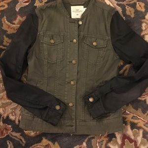 Olive green jacket with faux leather sleeves